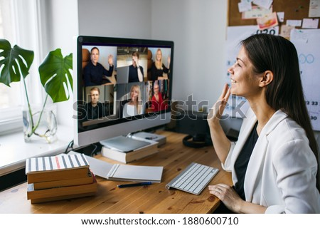 Work from home. Business video conferencing. Woman having video call via computer in the home office. Business team. Virtual house party. Online team meeting video conference calling from home