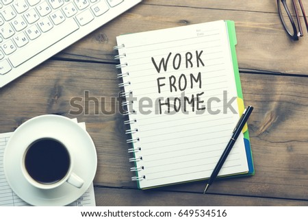 work from home text written on page and  coffee and keyboard on table #649534516