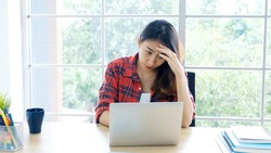 Work from home, Young asian woman struggle with laptop computer, Frustrated asia girl looking at laptop while studying online class, online business, e learning, People struggle with technology