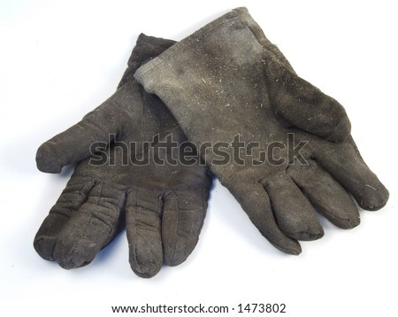 Work gloves. Used and worn material. Dirty and filthy safety gloves.