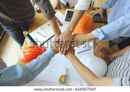 Work Group of Gngineer  people joining hands.(tool ,paper and Safety Helmet) #666007069