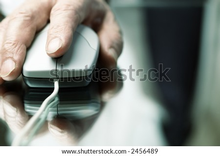 work (hand of the man with computer mouse,focus point on the finger,special tone photo f/x)