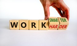 Work harder or smarter symbol. Businessman turns wooden cubes and changes words 'work harder' to 'work smarter'. Beautiful white background, copy space. Business and work harder or smarter concept.