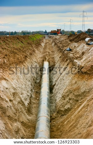 Work in progress burying gas pipe in a country area