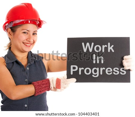 Work In Progress Sign Held By A Construction Worker - stock photo