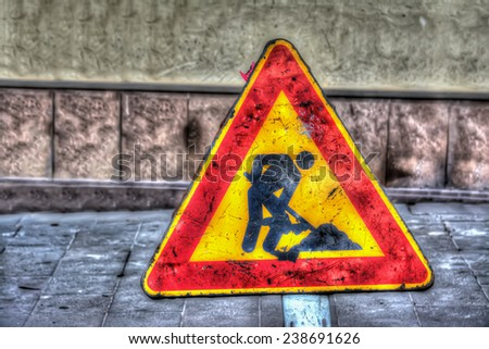 work in progress sign in a urban road. Processed for hdr tone mapping effect.