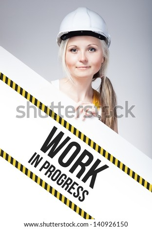 Work in progress sign placed on information board, worker woman