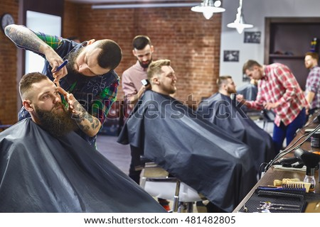 Work in the Barber shop. Four masters in the work.