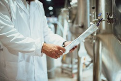 Work in the lab of a brewery is observing the process of brewing and fermentation.Brewing equipment. Plant for the production of beer.