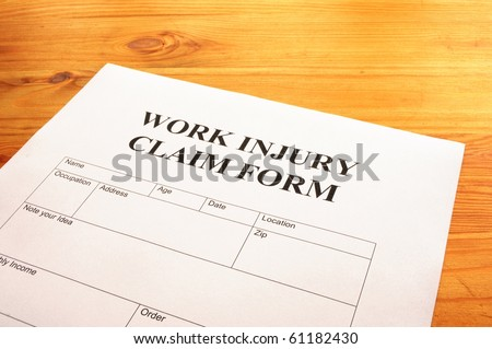 work injury claim form showing business insurance concept