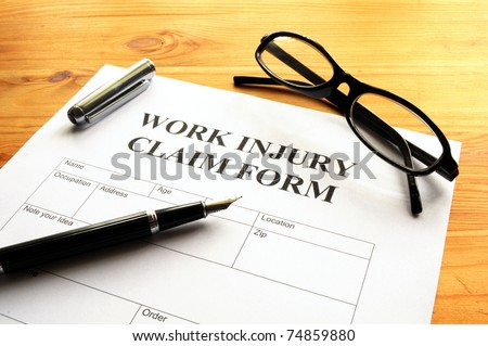 work injury claim form showing business insurance concept - stock photo