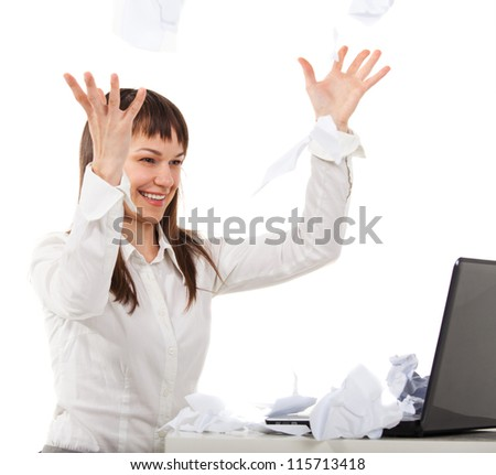 Work is finished. Young brunette woman looking for her laptop over papers