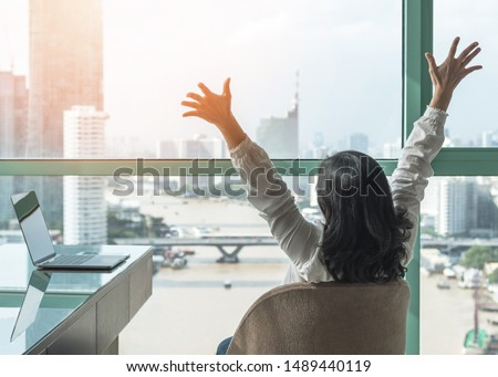 Work-life balance, work done and success celebration concept with happy woman take it easy casually resting in luxury business hotel or at home office workplace with computer pc laptop on desk