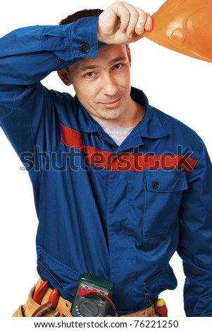 Work man in work-wear with instrument in studio against white background