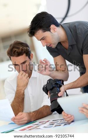 Work meeting in photo agency