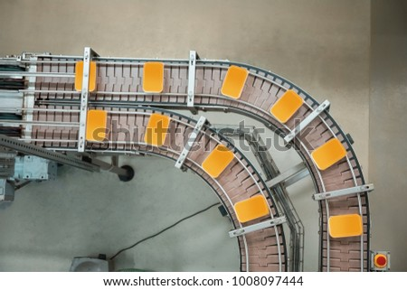 Work of the food production line on a conveyor machines #1008097444