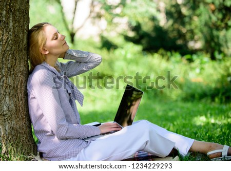 Work outdoors benefits. Woman with laptop work outdoors lean tree. Minute for relax. Education technology and internet concept. Girl work with laptop in park sit on grass. Natural environment office. #1234229293