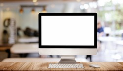 Work place concept : Mock up Blank screen computer desktop with keyboard in cafe or co-working background.