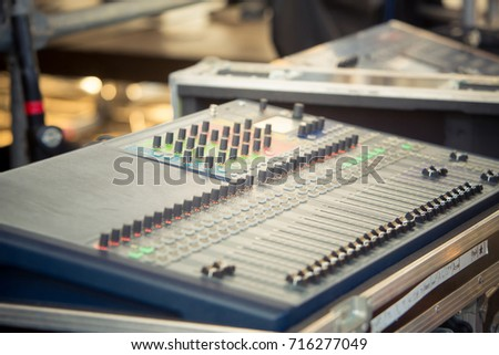 work place sound engineer's. mixing console. Mixer. The sound engineer's console. Sound engineer's fingers are pressing the button audio controller.