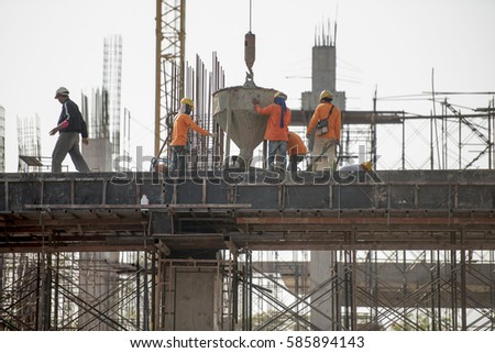 Work Safety officer or Civil Engineer. team worker on background of construction site