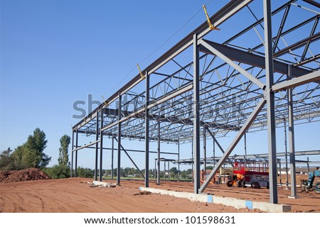 Work site and large steel frame of a large commercial building.