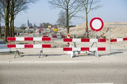 Work site closed with barriers for roadworks