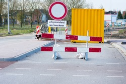 Work site closed with roadblock with prohibition sign for roadworks in the netherlands