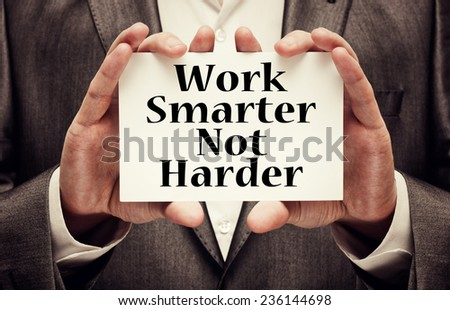 Work Smarter Not Harder Concept. Man holding a card with a motivational message text written on it Сток-фото ©