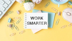 Work Smarter Not Harder Text written on notebook page, on the right. Concept image