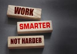 Work Smarter not harder words phrase on Wooden blocks business concept. self motivation concept.