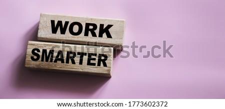 Work Smarter words phrase on Wooden blocks business concept. self motivation concept.