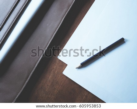 Work Space,Pen,paper,leather,lab top,notebook,camera,coffee,suit,ha #605953853