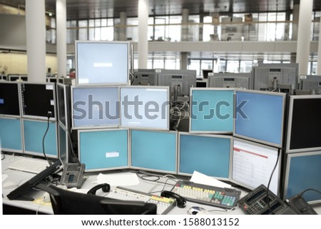 Work station with many computer monitors in office