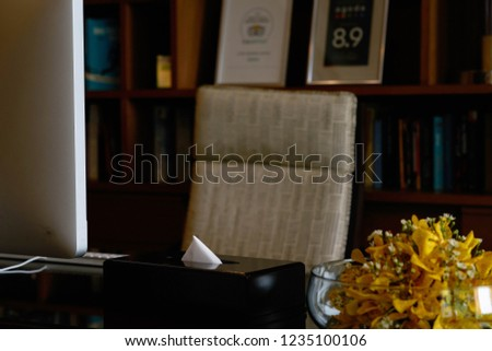Work table decorated by vase and clean paper and computer