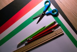 Work table, ruler, pencils, scissors, cardboard