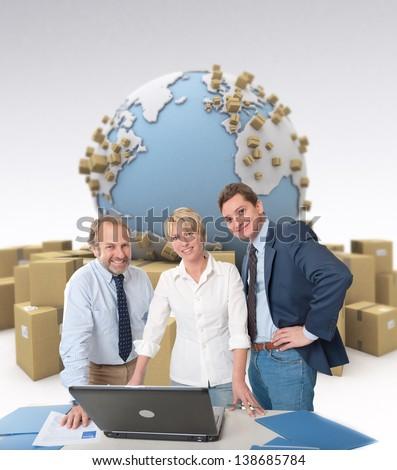 Work team around a computer in an international transportation context - stock photo
