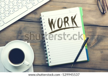 Work text on notebook with coffee and keyboard #529945537