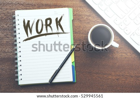 Work text on notebook with coffee and keyboard #529945561
