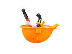 Work tool inside an orange safety helmet on a white background. Working tool. Plastic protective helmet for the worker. Worker tool. Hammer and pliers. Construction and repair. Background.