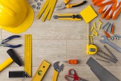 Work Tools frame on wood background