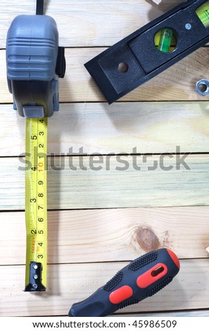 Work tools scattered over wooden planks