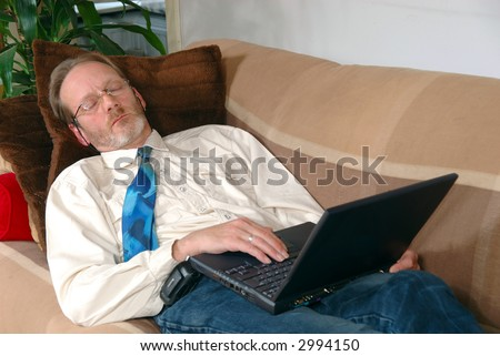 Workaholic, businessman sleeping with laptop on lap. Business, corporate concept.