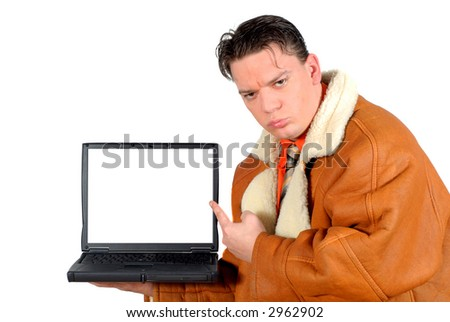 Workaholic, Young businessman pointing to blank  laptop screen. Business, advertizing, corporate concept.