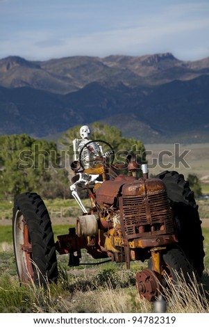 Worked to Death - Skeleton on a old tractor