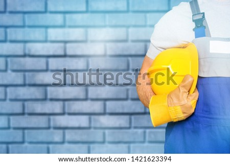Worker and dark texture in background. Concept of OSH (occupational safety and health) #1421623394