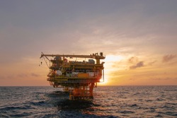 worker and offshore rig background THAILAN