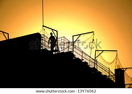 worker and sunset. under construction, working protection.