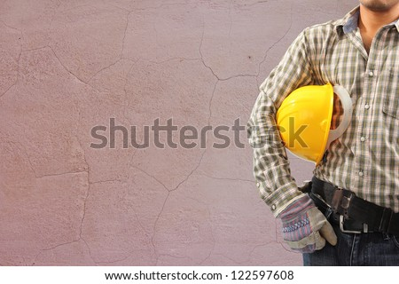 Worker and the cracked concrete vintage brick wall background #122597608