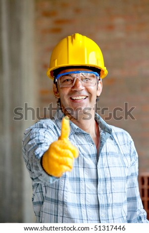 Worker at a construction site with thumbs up and smiling