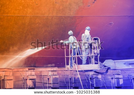 worker at floating dry dock...